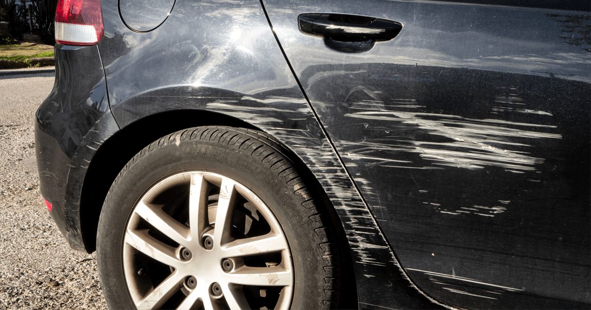 Scratched car, collision damage, requires car body shop